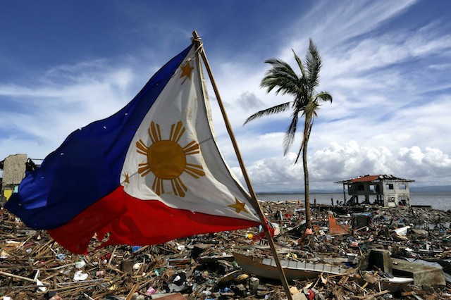 A lone Philippine Flag raised at the destruction of Tacloban after Haiyan. from: www.rappler.com